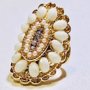 Ornate pearl rings in silver and gold tones